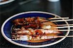Grilled shrimp japanese style skewered on a stick