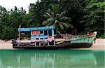 Old fishing boat moored on Phuket Island, Thailand.