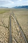 Aerial of desolate scenic highway through rural desert landscape of California, USA.