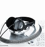 Professional DJ Vinyl Player with green Headphones on it