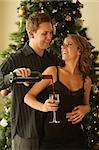 Happy couple having some vine