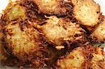 Homemade, potato latkes (pancakes) for Hanukah draining on paper towel.