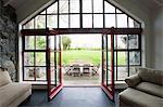 Room with doors open onto patio