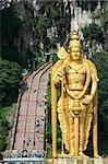 golden statue of lord muragan outside the batu caves hindu shrine near kuala lumpur malaysia