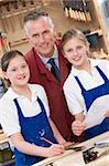 Schoolgirls and teacher in woodwork class