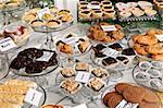 Various desserts on display in bakery window