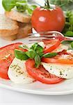 Caprese salad with red tomato and mozzarella