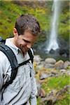 Man Hiking by Waterfall, Hood River, Oregon, USA