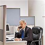 Businessman talking on telephone at desk
