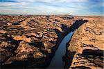 River carved through a rocky, desert landscape. Horizontal shot.