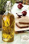 Still life with olive oil, onion, salt, bread, rosemary