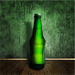 cool beer bottle at wooden floor over grunge wall