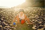 Portrait of Boy Digging in Sand on Beach