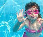 underwater little girl pink bikini goggles blue swimming pool