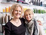 Women embracing in hair salon
