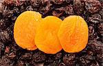 dried fruits, orange dry apricot on raisins