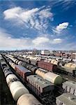 Railroad cars on a railway station. Cargo transportation. Work of industry. Urban scene