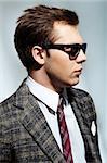 Profile of elegant man in dark eyeglasses