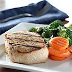 Pork loin filet with carrots andbroccoli with hollandaise sauce