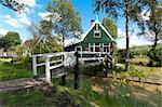 traditional dutch house with wooden footbridge in the zaanse schans, netherlands