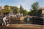 Painter on Bridge over Egelantiersgracht, Amsterdam, Netherlands