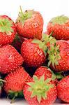 Fresh Strawberrys set against a plain background