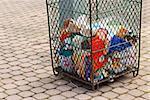 Metal mesh garbage bin in a city park