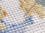 needle in a cross stitch design