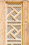Wood arabian ornament. Detail of wall.