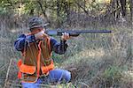 Man hunting in a field in fall