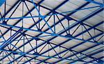 white-blue geometric construction ceiling of stadium tribune