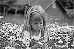 Little girl in a daisy field.