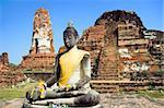 Seated Buddha statue at the temple of Wat Mahatat in Ayutthaya near Bangkok, Thailand.