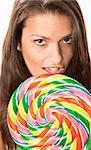 Pretty young Hispanic woman with big lollipop