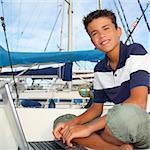 boy teen seat on boat marina laptop computer summer vacation