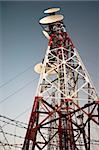 Antenna radio station tower on dark blue sky