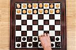Chess pieces arrangement closeup on chessboard