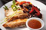 Juicy chicken fillets on roosterkoek with vegetables