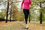 Girl running among autumn trees