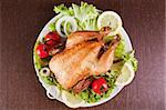 Roast chicken with fresh vegetables, studio shot