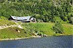Shelter Samotnia and lake Maly Staw in polish mountains Karkonosze