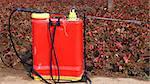 A red sprinkler for spreading agricultural chemicals in a garden