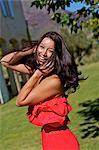 Beautiful energetic brunette in a garden