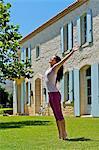 Beautiful brunette performing yoga outside