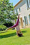 Beautiful brunette performing a cartwheel