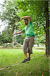 Man on Slackline with Hula Hoop