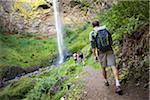 Four Friends Hiking near Waterfall, Columbia River Gorge, near Portland, Oregon, USA