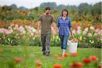 Couple Picking Flowers, Sauvie Island, Oregon, USA