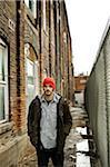 Man Standing in Muddy Alley