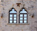 Old window on old Medieval castle